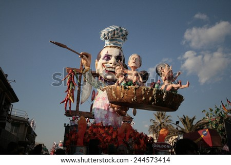 VIAREGGIO, ITALY - FEBRUARY 9: Festival, the parade of carnival floats with dancing people on streets of Viareggio. February 9, 2009, taken in Viareggio, Italy - stock photo
