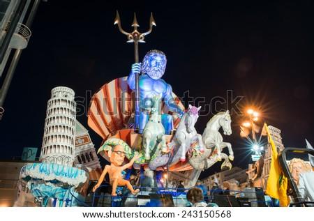 VIAREGGIO, ITALY - FEBRUARY 22, 2014: Float about carnival mask at Viareggio Carnival. The symbol of the carnival of Viareggio is Burlamacco, designed and invented by Uberto Bonetti in 1930. - stock photo
