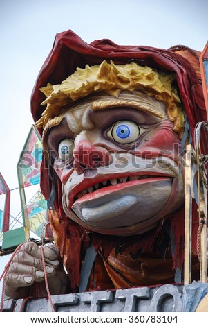 Viareggio, Italy - February 24, 2010: Parade float During The Carnival of Viareggio on the Tuscany Italy. The theme is the voter Italian politician like the hunchback of Notre Dame - stock photo