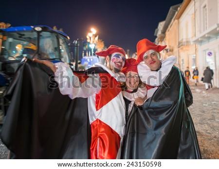 VIAREGGIO, ITALY - FEBRUARY 22, 2014: People enjoy Carnival floats parade on the promenade of Viareggio, during the famous Carnival of Viareggio. - stock photo