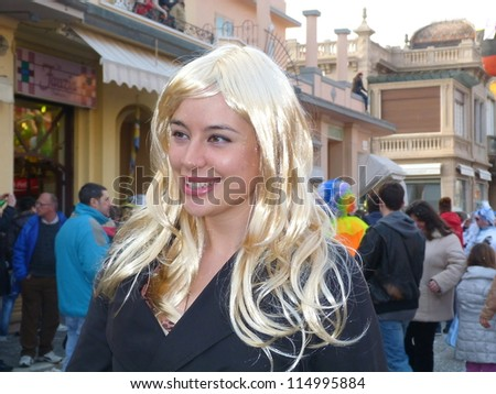 VIAREGGIO, ITALY - MARCH 4 An undefined woman in carnival mask at the parades on the promenade during the famous annual Italian Carnival of Viareggio on march 4, 2012 in Viareggio, Italy - stock photo