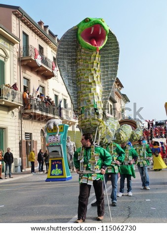 VIAREGGIO, ITALY - MARCH 4:Detail of carnival float at the parades on the promenade during the famous annual Italian Carnival of Viareggio on march 4, 2012 in Viareggio, Italy - stock photo