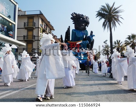 VIAREGGIO, ITALY - MARCH 4: Group masked at the parades on the promenade during the famous annual Italian Carnival of Viareggio on march 4, 2012 in Viareggio, Italy - stock photo