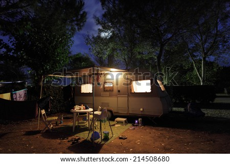 VIAS, FRANCE - OCT 6: European mobile home on a camping site at night. October 6, 2011 in Vias, Herault department, Languedoc-Roussillon, France - stock photo