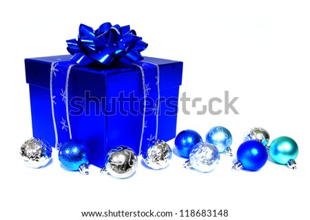 Vibrant blue Christmas gift box with baubles over white - stock photo