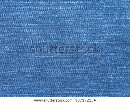 Vibrant blue striped jeans denim textile closeup background - stock photo