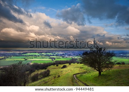 Vibrant colors in the landscape before storm over English countryside - stock photo