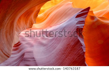 vibrant colors of eroded sandstone rock in slot canyon, antelope valley, page, arizona, usa. red rock wave eroded