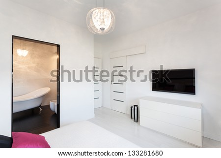 Vibrant cottage - Bright bedroom interior with tv - stock photo