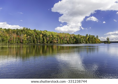 Vibrant Fall Colors Reflecting off a Lake in Autumn - Silent Lake Provincial Park, Ontario, Canada