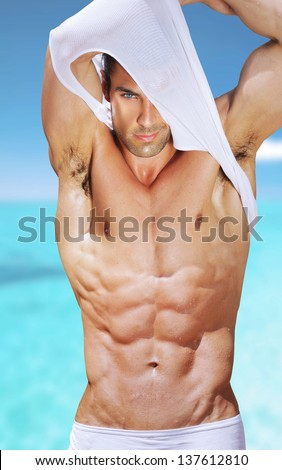 Vibrant fashion portrait of a sexy muscular fit man - stock photo