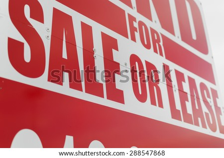 Vibrant For Sale Or Lease Sign - Closeup.  Textured image of red for sale or lease sign. - stock photo