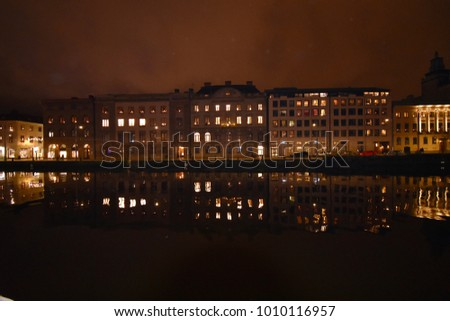 Vibrant Gothenburg at night - old houses reflected in the waters - beautiful lights