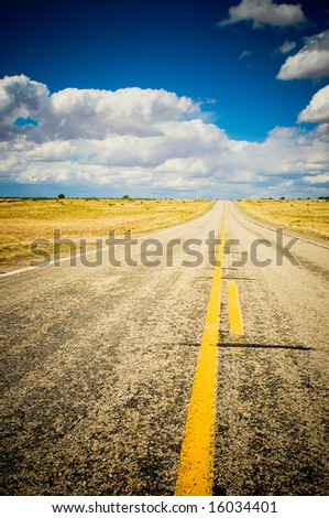 vibrant image of highway and blue sky