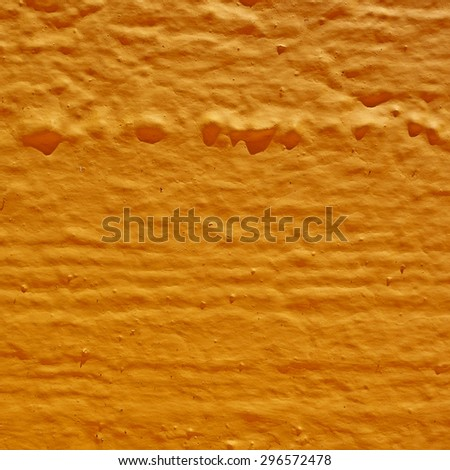 vibrant orange rough surface close-up