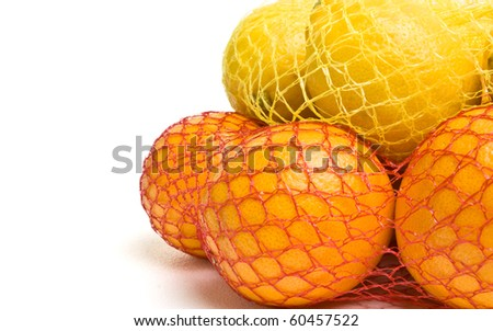 Vibrant Oranges and Lemons from low perspective isolated against white.