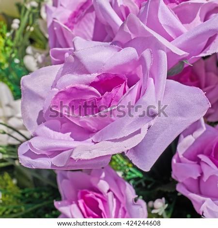 vibrant pink fake rose flower closeup - stock photo
