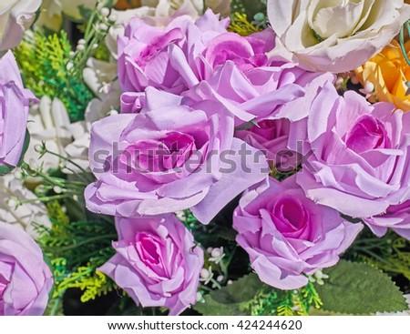 vibrant pink fake rose flowers closeup - stock photo
