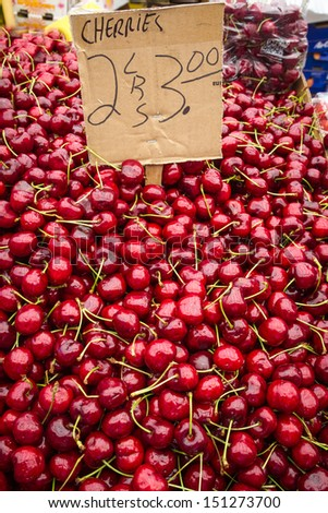 Vibrant red cherries for sale - stock photo