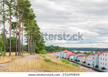 Vibrant residential neighborhood surrounded by nature. Modern living. - stock photo