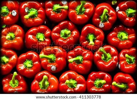 Vibrant stack of red peppers.