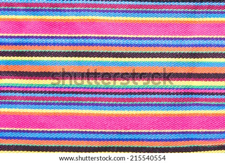 Vibrant stipey fabric as a background image - stock photo
