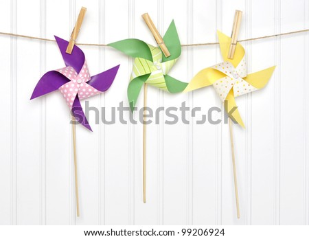 Vibrant Summer Party Pinwheels on a Clothesline with White Background. - stock photo