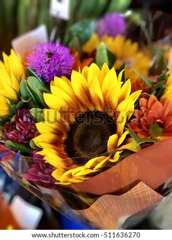 Vibrant sunflower floral arrangement.