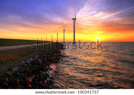 Vibrant sunset water windmills HDR