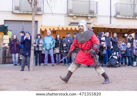 VIC, CATALONIA, SPAIN - DECEMBER 2014 - Medieval combat. Medieval market in Vic on December 6, 2014