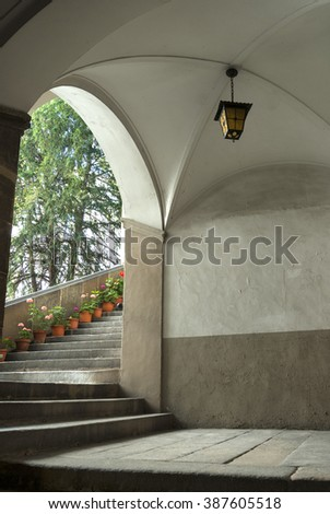 VIC, SPAIN - JULY 13, 2007: Vic (Catalunya, Spain): the historic palace: staircase with potted plants and flowers