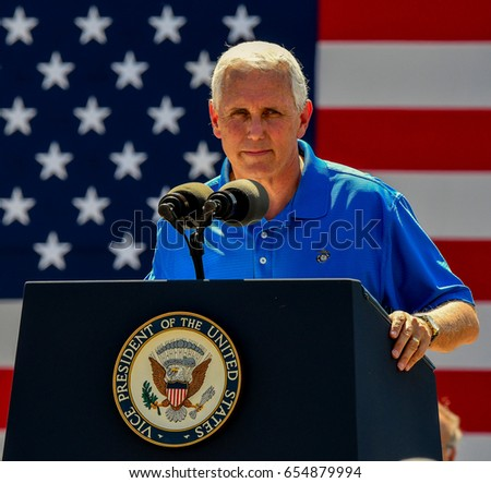 Vice President Mike Pence addresses the crowd at Senator Joni Ernst's 3rd annual charity motorcycle ride to benefit military veterans at the Central Iowa Expo center in Boone Iowa, 3 June, 2017.