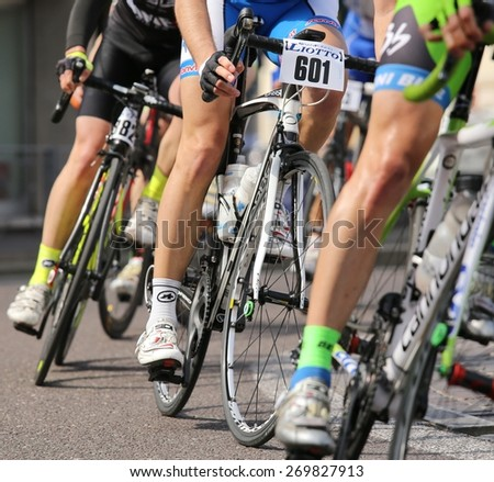 Vicenza, italy - april 12, 2015 bikers run fast on racing bikes during cycle road race
