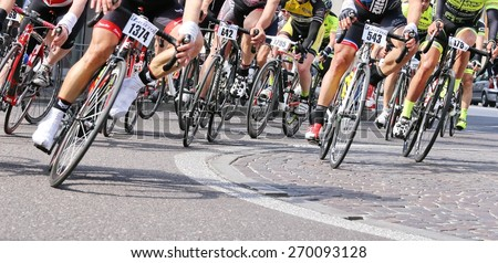 Vicenza, italy - april 12, 2015 bikers run fast on racing bikes during cycle road race - stock photo