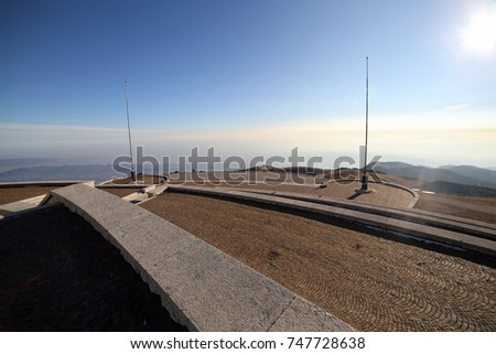 Vicenza, VI, Italy - December 8, 2015: Panoramic view of War Memorial of First War World called Ossario del Monte Grappa. Long main road and an ancient cannon