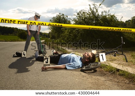 Victim of accident - traffic police investigation - stock photo