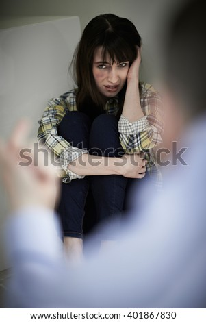 Victim Of Domestic Abuse Being Threatened By Man - stock photo