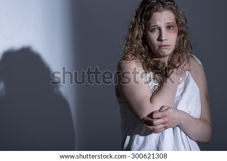 Victim of sexual abuse on gray background - stock photo