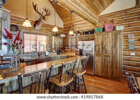Victor, Idaho USA Nov. 12, 2014 The kitchen and bar in a modern log cabin in the mountains - stock photo