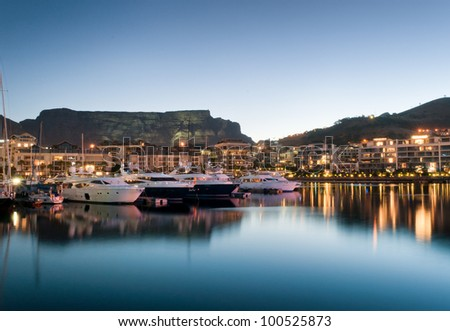Victoria and Alfred Waterfront as the hot summers sun sets behind Table Mountain and the night lights start to shine