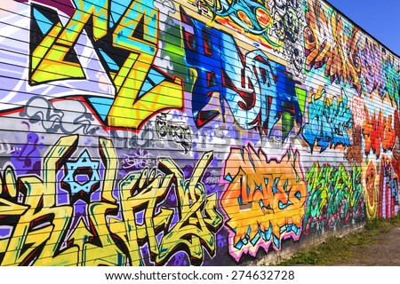 VICTORIA - B.C.  CANADA- APR 9 2015 : Street art by unidentified artist in Victoria  The art form (graffiti) is allowed and  management to recognized.  The street art in a vibrant urban culture.  - stock photo