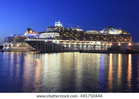 VICTORIA, BC, CANADA - JUN 26 2016. Cruise ships at night in Victoria. Each year hundreds of cruise ships docks in for a day or a few hours. Ogden Point is also the place to see them come into port. - stock photo