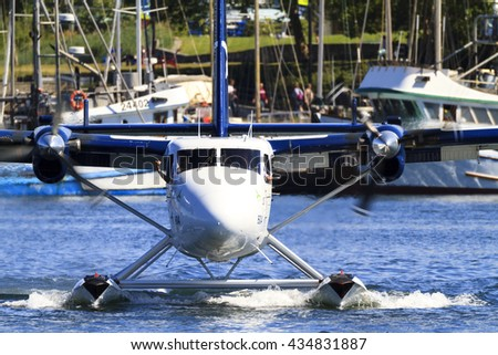 VICTORIA, BC, CANADA - JUN 3 2016: Float-plane traffic in the inner harbor. This transportation is vital and very frequent between Vitoria and Vancouver, also the flight is very pictures.