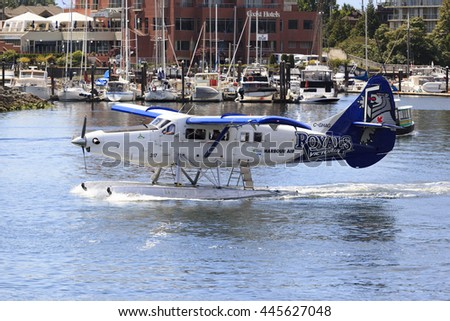 VICTORIA, BC, CANADA - JUN 24 2016: Float-plane traffic in the inner harbor. This transportation is vital and very frequent between Vitoria and Vancouver, also the flight is very pictures.
