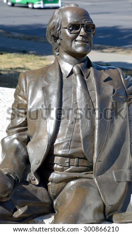 VICTORIA BC CANADA JUNE 23 2015: Statue of Michael Collard Williams (1930 â?? 2000) was a self-made millionaire and high profile community member in Victoria society since his arrival here in 1958. - stock photo