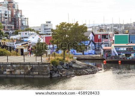 VICTORIA BC CANADA JUNE 24 2016: Victoria Inner Harbor, Fisherman Wharf is a hidden treasure Area has floating homes, boats, piers, and restaurants and eco-tour adventures