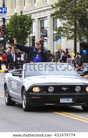 VICTORIA,BC,CANADA-MAY 23,2016: People and organizations  from Canada and USA in the Victoria Day parade along Douglas Street. This is Victoria's largest parade, attracting well over 100,000 people..
