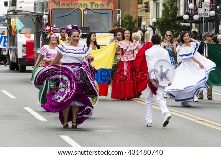 VICTORIA,BC,CANADA-MAY 23,2016: People and Organizations  from Canada and USA in the Victoria Day parade along Douglas Street. This is Victoria's largest parade, attracting well over 100,000 people..  - stock photo