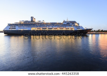 VICTORIA, BC, CANADA - MJUN 26 2016. Cruise ships at night in Victoria. Each year hundreds of cruise ships docks in for a day or a few hours. Ogden Point is also the place to see them come into port. - stock photo