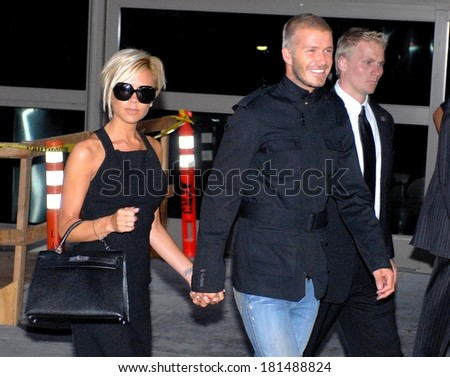 Victoria Beckham, carrying an Hermes Kelly bag,, David Beckham out and about for LAX Airport arrival, LAX Airport, Los Angeles, CA, July 12, 2007 - stock photo